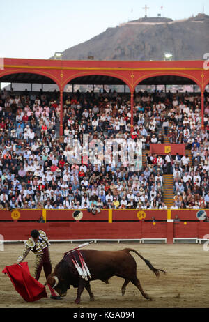 Peruvian Joaquín Galdos performs at the bullring during a corrida of the 'Fair of the Lord of the Miracles' (Feria - Stock Photo