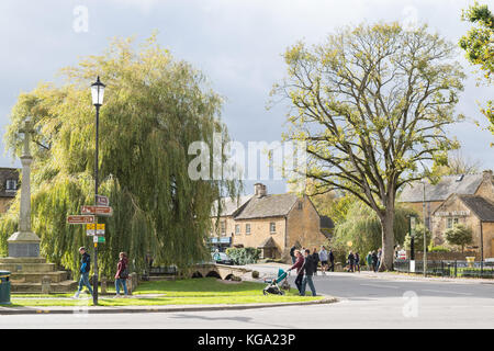 Bourton on the Water - a busy and popular Cotswold village in Gloucestershire, England, UK - Stock Photo