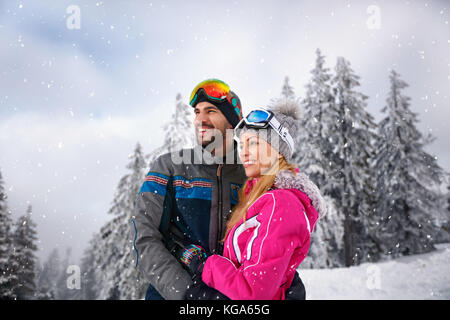 Happy couple in love skiing on winter holiday - Stock Photo