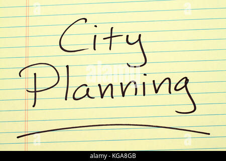 The word 'City Planning' underlined on a yellow legal pad - Stock Photo