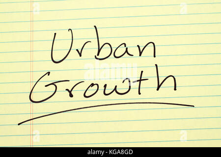The word 'Urban Growth' underlined on a yellow legal pad - Stock Photo
