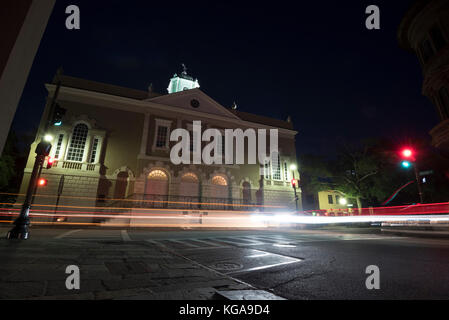 The Old Exchange and Provost Dungeon in Charleston, SC with cars going past at night. - Stock Photo
