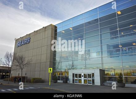 Sears Store Building Exterior in Southcentre Shopping Mall in South Calgary, Alberta Canada with Sale Deals due - Stock Photo
