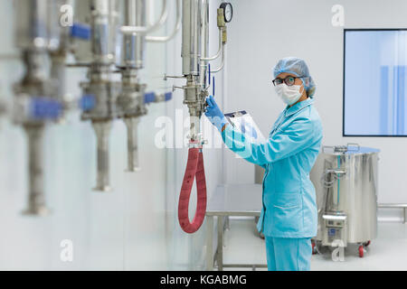 scientist is working with pressure meter in lab - Stock Photo