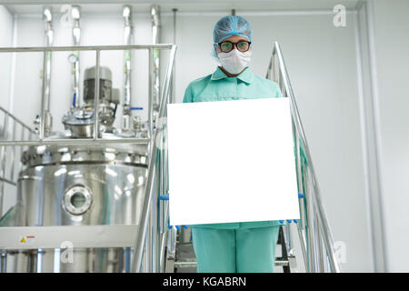 doctor holding empty banner in front - Stock Photo
