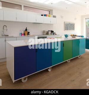 Movable kitchen island on castor wheels, retro design painted in ombre colours with Silestone worktop. - Stock Photo