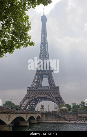 Paris; France-May 05; 2017: View of the bridge Jena and the Eiffel Tower. Around the walk tourists - Stock Photo