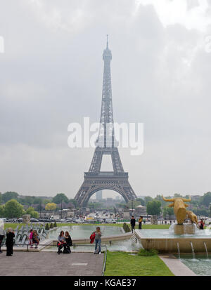 Paris; France-May 05; 2017: View of the bridge Jena and the Eiffel Tower. In the foreground, tourists are photographed - Stock Photo