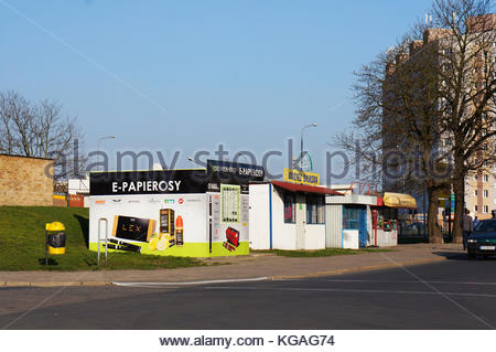 POZNAN, POLAND - APRIL 10, 2015: Row of small shops by a road - Stock Photo
