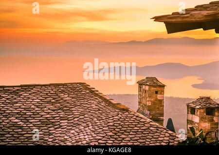 Amazing view from a slate roof with chimneys of a traditional house in Pelion on the mountain of the gods called - Stock Photo