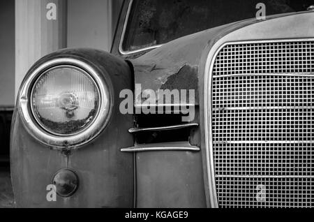 The front side of an old car. Giving emphasis to metal parts.No matter its age,luxury and magnificence still dominate. - Stock Photo