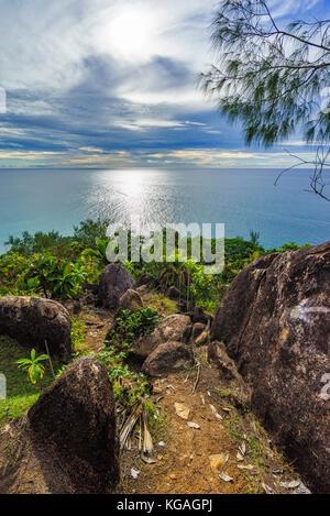 Hiking throug the jungle between the paradise beaches anse lazio and anse georgette, praslin, seychelles - Stock Photo