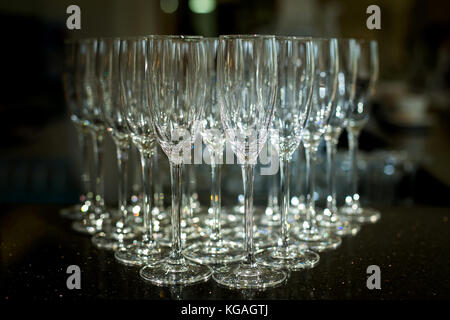 Group of empty champagne glasses. Empty glasses set in restaurant. - Stock Photo