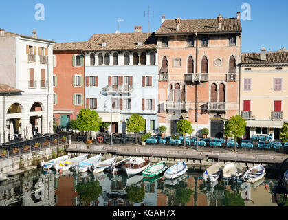 DESENZANO DEL GARDA, ITALY. 23rd October 2017. The pretty old harbour in Desenzano draws locals and tourists to - Stock Photo