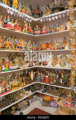 Religious statues and photos for sale Shakti Saree & Spiritual on Liberty avenue in Richmond Hill, Queens, New York - Stock Photo