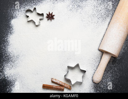 Ingredients for christmas baking - flour, spices and cookie cutters. - Stock Photo