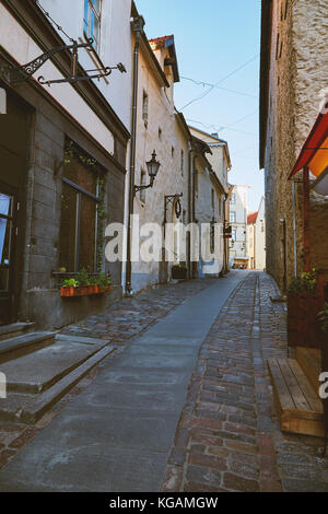 One of the streets of the old city of Tallinn, Estonia without people on a bright sunny day - Stock Photo