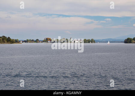 Chiemsee with Frauenchiemsee island in a distance seen from Prien - Stock Photo