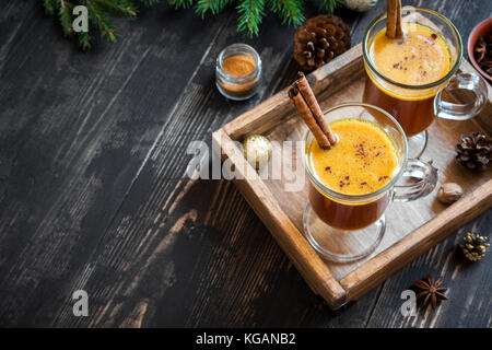 Hot buttered rum cocktail with cinnamon for Christmas and winter holidays. Homemade festive hot Christmas drink. - Stock Photo