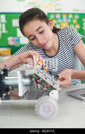 Female Pupil In Science Lesson Studying Robotics - Stock Photo