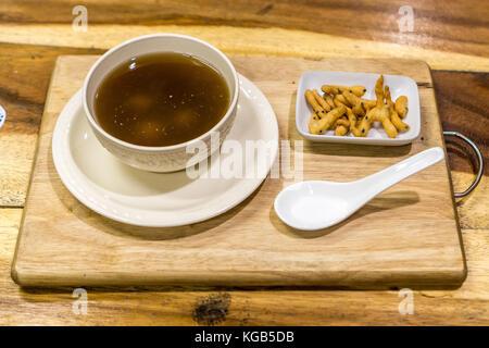 Chiang Rai, Thailand - ginger tea with rice balls - Stock Photo