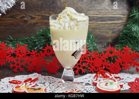 Dessert with Irish liqueur jelly cubes with whipped cream in a glass. Christmas and New year concept - Stock Photo