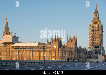 The Houses of Parliament at sunrise in Autumn from Westminster Bridge with blue sky, London, UK - Stock Photo