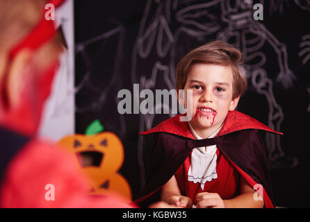 Portrait of boy dressed up as halloween vampire - Stock Photo