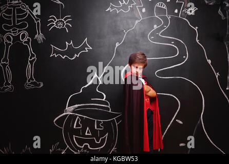 Boy in vampire costume posing - Stock Photo