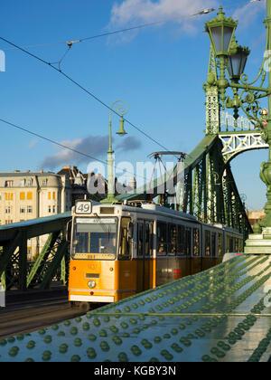 Tram passing Liberty Bridge in Budapest, Hungary - Stock Photo