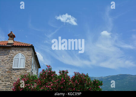 An historic house and blue summer sky in Budva old town, Montenegro. - Stock Photo
