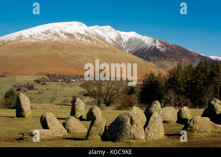 Snow covered Blencathra near Keswick in the Lake District and Castlerigg Stone Circle - Stock Photo