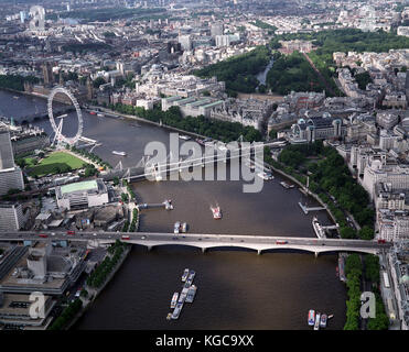 A aerial view of London showing the River Thames, , the Houses of Parliament, Big Ben, The London Eye, Charing Cross - Stock Photo