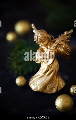 christmas angel playing mandolin with sparkling golden decorations stock photo - Christmas Angel Decorations