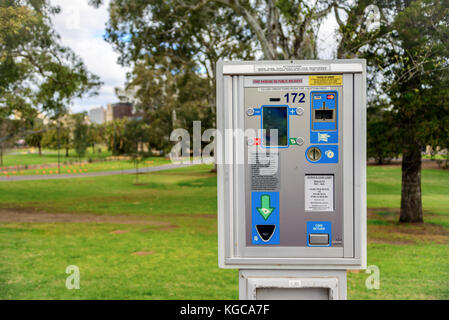 Adelaide, Australia - August 27, 2017: Parking meter  installed near St. Peter's Cathedral in Adelaide CBD with - Stock Photo