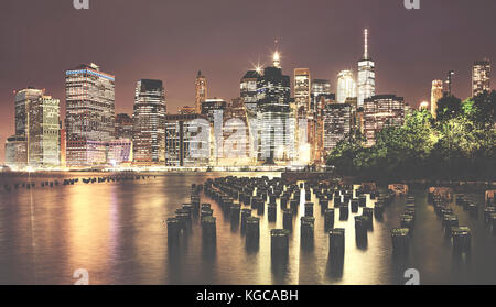 Vintage toned picture of Manhattan at night, New York, USA. - Stock Photo