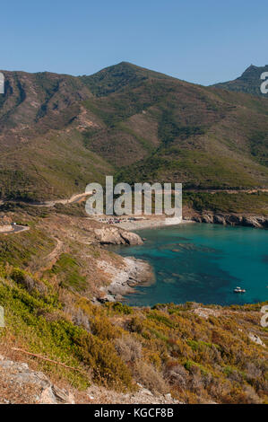 Corsica: panoramic view of Anse d'Aliso (Plage d'Alisu), one of the most remote beaches of the western side of Cap - Stock Photo