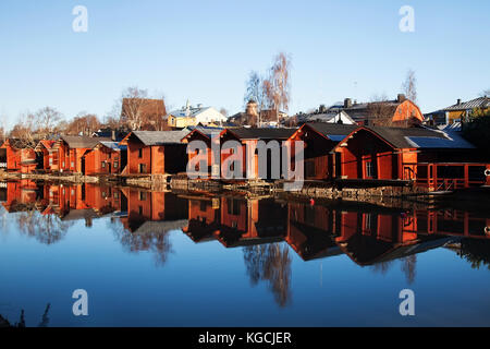 Porvoo, Finland. Classic old wood houses and their reflection in river - Stock Photo