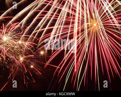 fireworks - a display of one big and a few small ones on black night sky - Stock Photo