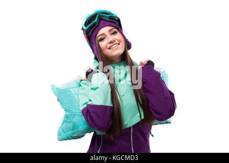 cheerful young pretty woman in purple ski coat and goggles - Stock Photo