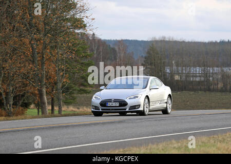 SALO, FINLAND - OCTOBER 31, 2015: Silver Tesla Model S electric car on the road in South of Finland. Tesla will - Stock Photo