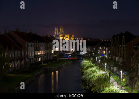 A night time view towards the illuminated Beverley Minster in the market town of Beverley, East Yorkshire - Stock Photo