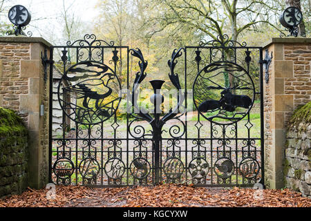 Wrought Iron Gates In Stone Archway Adjacent Wooden Door