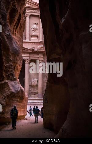 Pink sandstone, Nabataean Treasury, Al Khazneh, viewed from end of the Siq gorge narrow passage, Petra, Jordan, - Stock Photo