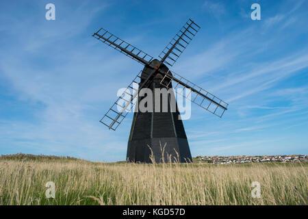 Beacon Mill at Rottingdean which is a coastal village near Brighton. - Stock Photo