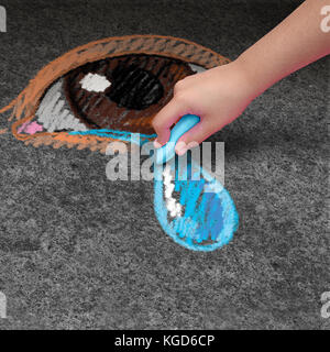 Child depression psychology and children mental health concept as a kid with chalk drawing on pavement a human eye - Stock Photo