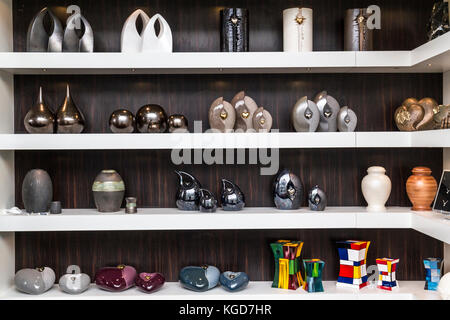 Bologna, BO, Italy - April 3, 2016: many urns with original design and made with different colours and materials - Stock Photo