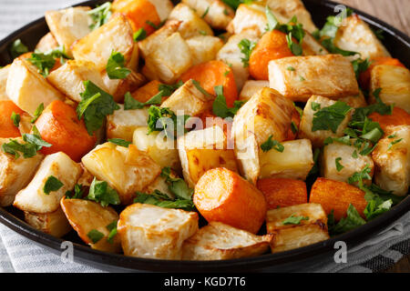 Baked celery root and carrot macro on a plate. horizontal