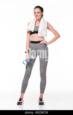 sportswoman with towel and bottle of water - Stock Photo