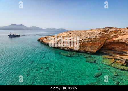 A boat with tourists at Koufonissi island in Cyclades, Greece - Stock Photo